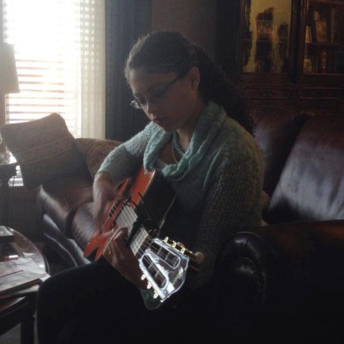 Cara playing guitar