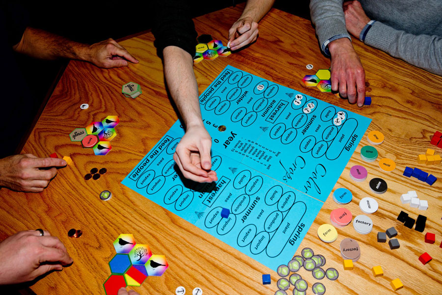 People prototyping a board game